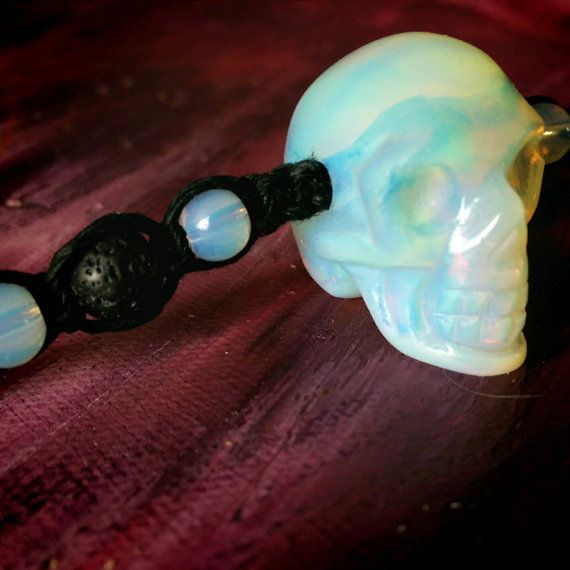 Check out this item in my Etsy shop https://www.etsy.com/ca/listing/266395052/carved-opalite-skull-black-hemp-macrame
