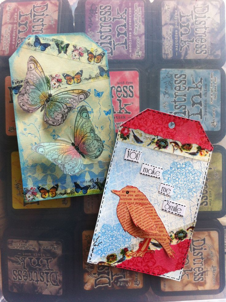 Pretty vellum butterflies and a printed bird stamps... made with gesso, washi tape and Tim Holtz Distress paints.