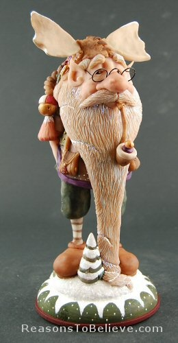 Moose - Yukon Kringle by Dennis Brown. He sculpts original clay sculptures of Santa's and elves. One of a kind, completely hand sculpted from polymer clay, fired and then hand-painted. Signed by Dennis Brown.