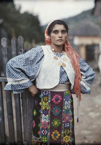 A Gypsy girl poses in traditional clothing and jewelry. Autochrome photo-1910-20s