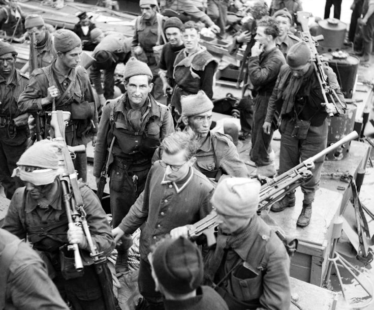 A German prisoner being escorted at Newhaven. He was captured during the Dieppe Raid by No. 4 Commando, 1942