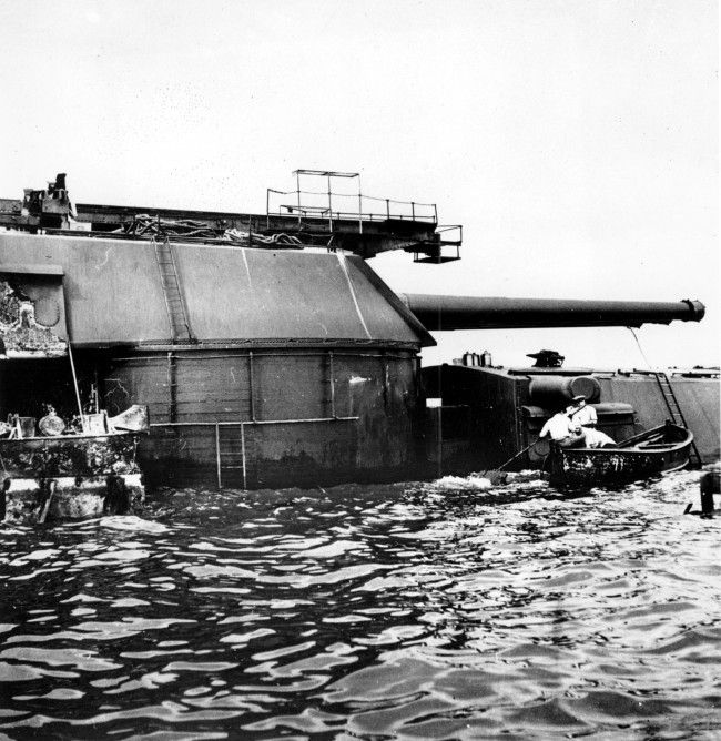 American divers work around the aft turrets of the battleship USS Arizona at Pearl Harbor, Hawaii on Feb. 2, 1942 during World War II. The Arizona was sunk and destroyed during the Japanese aerial attack on Pearl Harbor