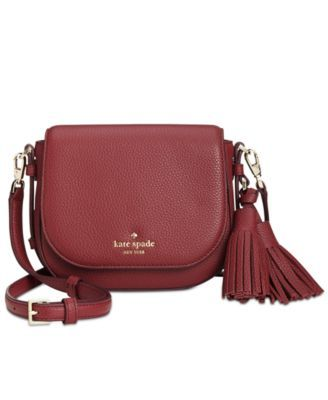 Pull off contemporary cool with kate spade new york's compact Penelope crossbody; the classic silhouette is updated with a modern matte pebbled leather finish, while tassel details provide a touch of