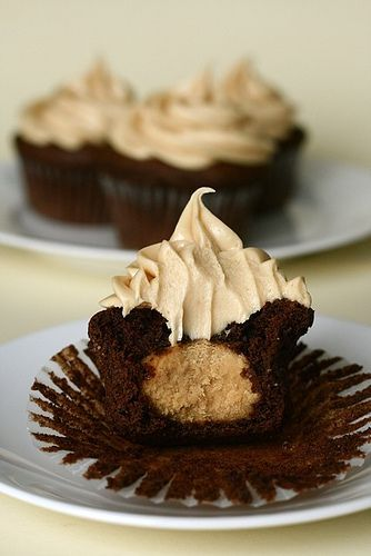 chocolate cupcakes filled & topped with peanut butter!  Must make these soon!