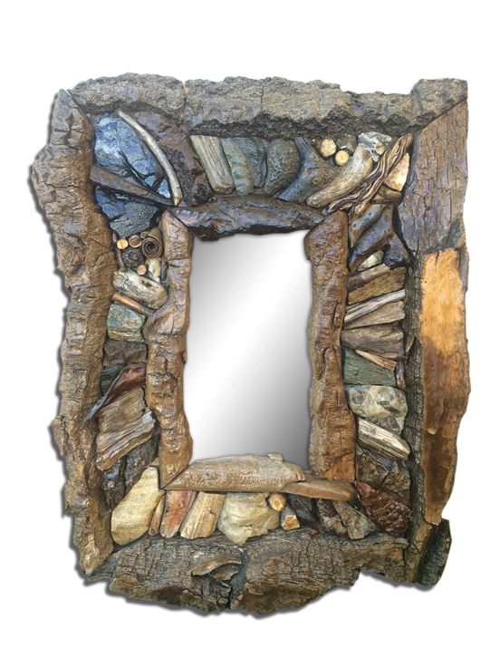 this mirror is made from everything natural, all harvested from local regions of Alberta. It has a unique bark border.