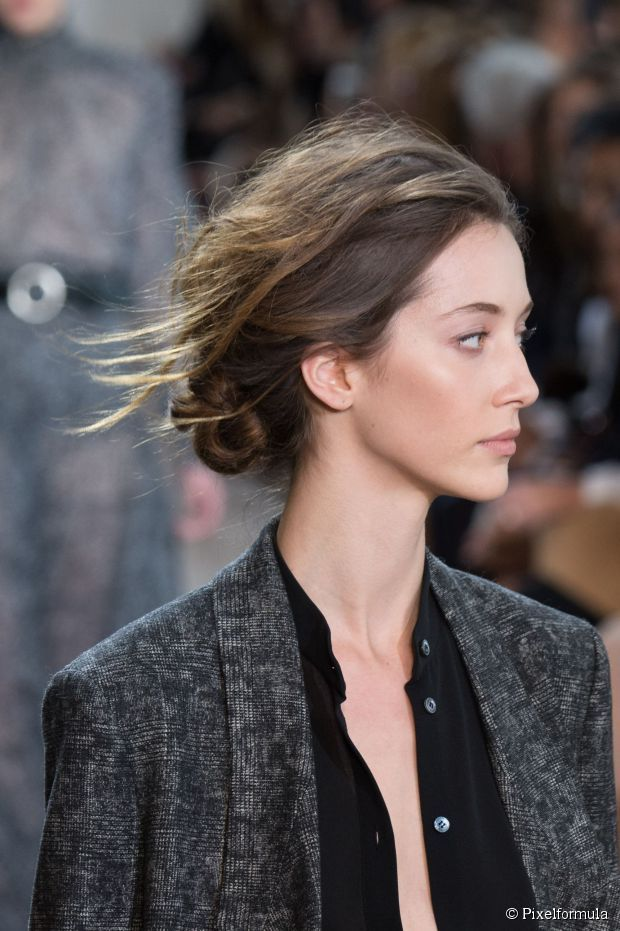 The hairstyle you can wear anywhere: Messy low chignon updo.