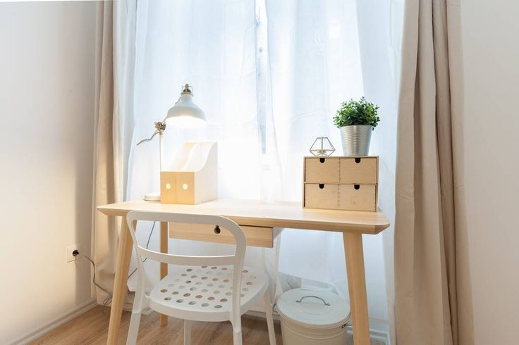 Wooden desk paired with white decoration.