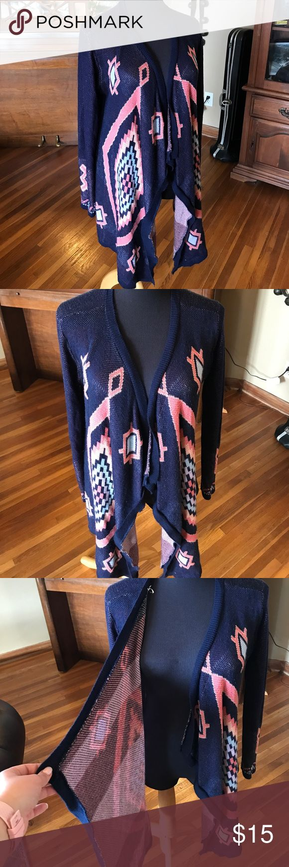 Long Draped Aztec Print Cardigan Gorgeous, long draped cardigan.  No buttons or ties. Navy blue and coral mostly. No discernible flaws, but there are some slight are of pilling die to the fabric type. Overall, great condition. Size large. Say What? Sweaters
