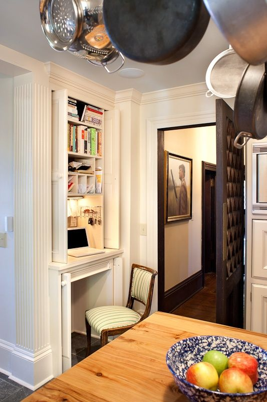Hideaway desk nook with pocket doors. Also like pocket doors for lower portion so cohesive look when not in use