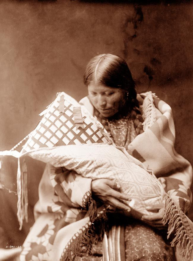 in 1905. Curtis captioned the image, Cheyenne Woman and Child
