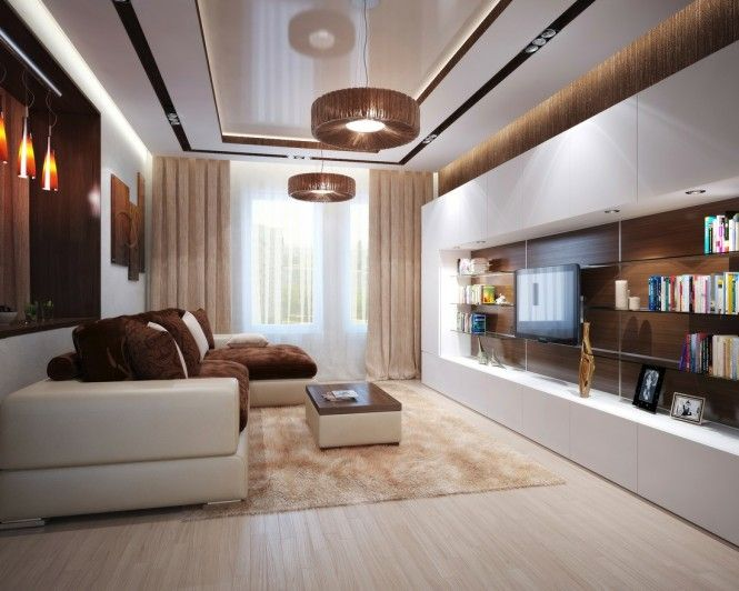 The furniture hugs this modern space, with an extensive entertainment unit and generous L-shaped sofa–the perfect place to curl up and watch a movie on that flat screen TV.