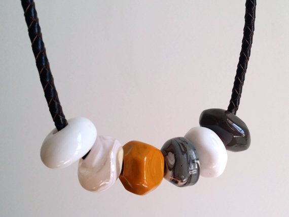 Hey, I found this really awesome Etsy listing at https://www.etsy.com/listing/180461484/geometric-lampwork-beads-on-leather