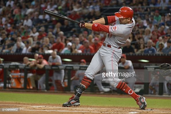 News Photo : Joey Votto of the Cincinnati Reds hits a two run...