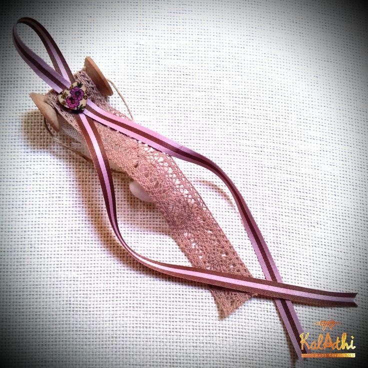 Wooden bobbin with lace ribbon by KalAthi photo © KalAthi