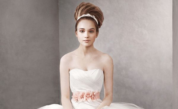 Now, with her White by Vera Wang Spring 2012 collection, which is sold exclusively through David's Bridal locations, New York based designer Vera Wang dresses you on your special day as well.
