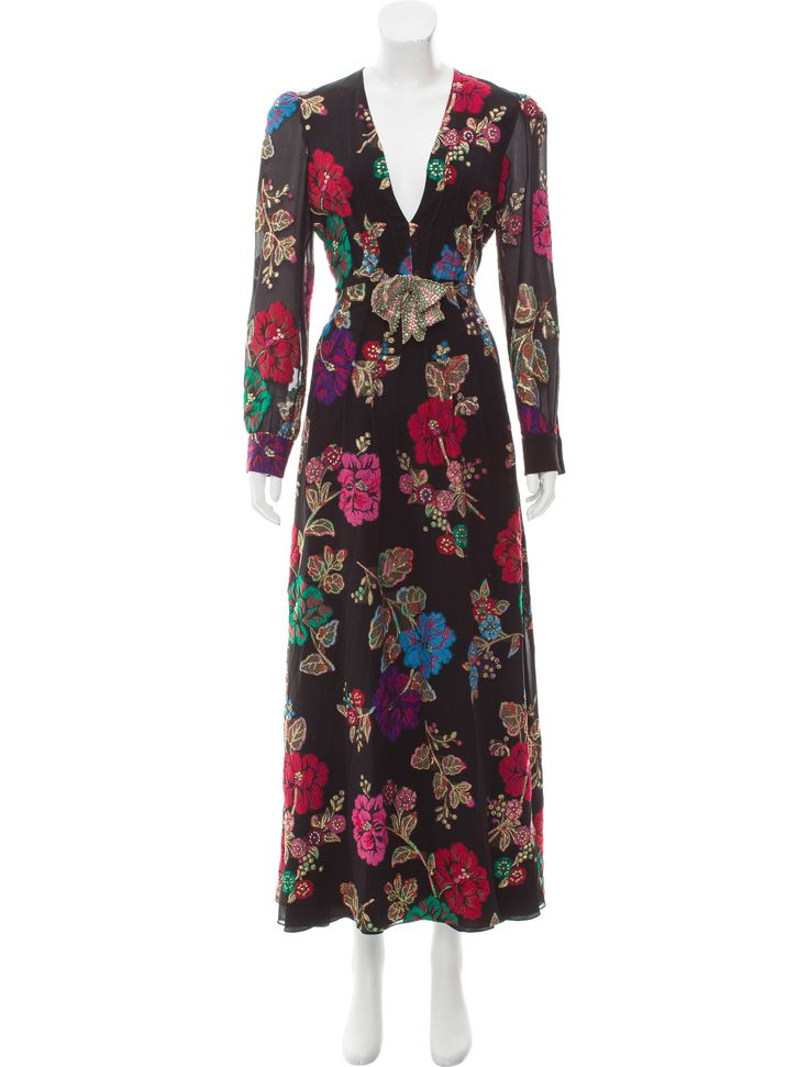 Black and multicolor Gucci silk-blend jacquard dress with flower garden pattern throughout, V-neckline, semi-sheer long sleeves, detachable contrasting embellished bow at center front waist and concealed zip closure at center back.