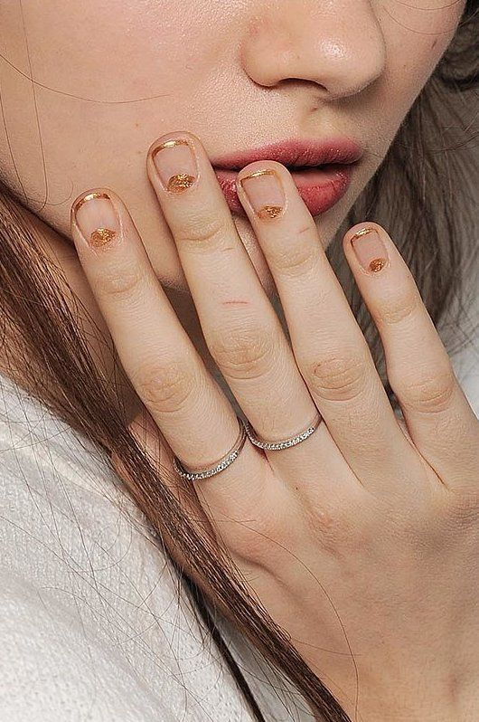 5. This is definitely one of our favorites from Tadashi Shoji FW 2014.  Add some oomph by pairing two nail trends with a naked nail. This gold tip and embellished nail bed (a.k.a. half-moon mani) combo is tasteful yet trendy.