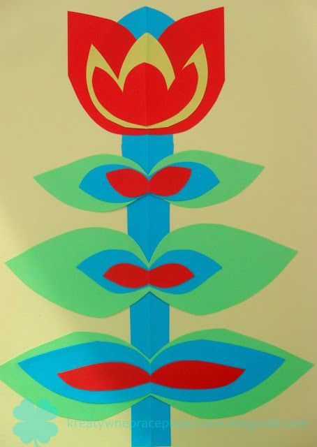 Art project for kids: symmetrical cut-out paper.