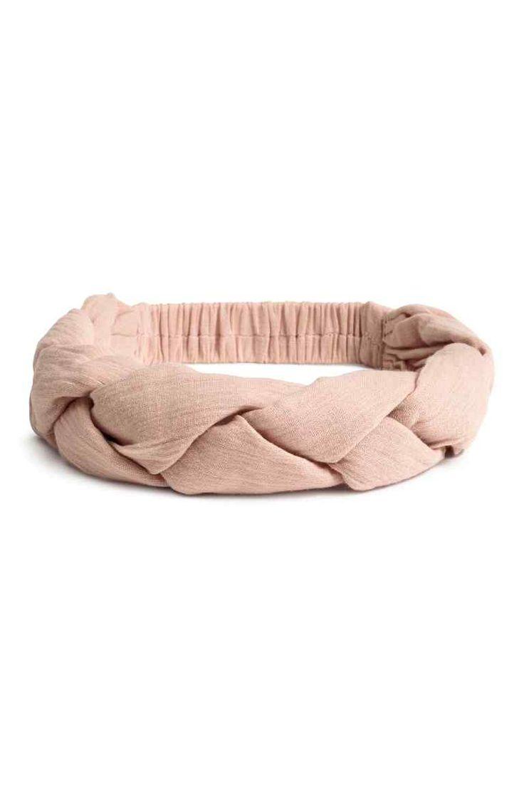 Bandeau tressé en coton: Bandeau tressé en coton tissé. Élastique habillé sur l'arrière.
