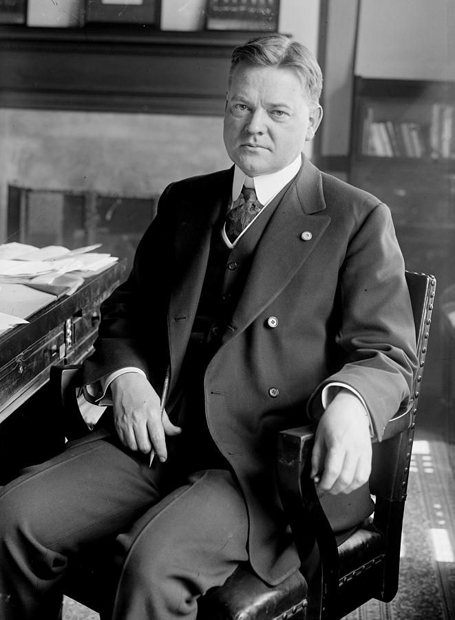 president Herbert Hoover Photograph - President Herbert Hoover Sitting At Desk by International Images