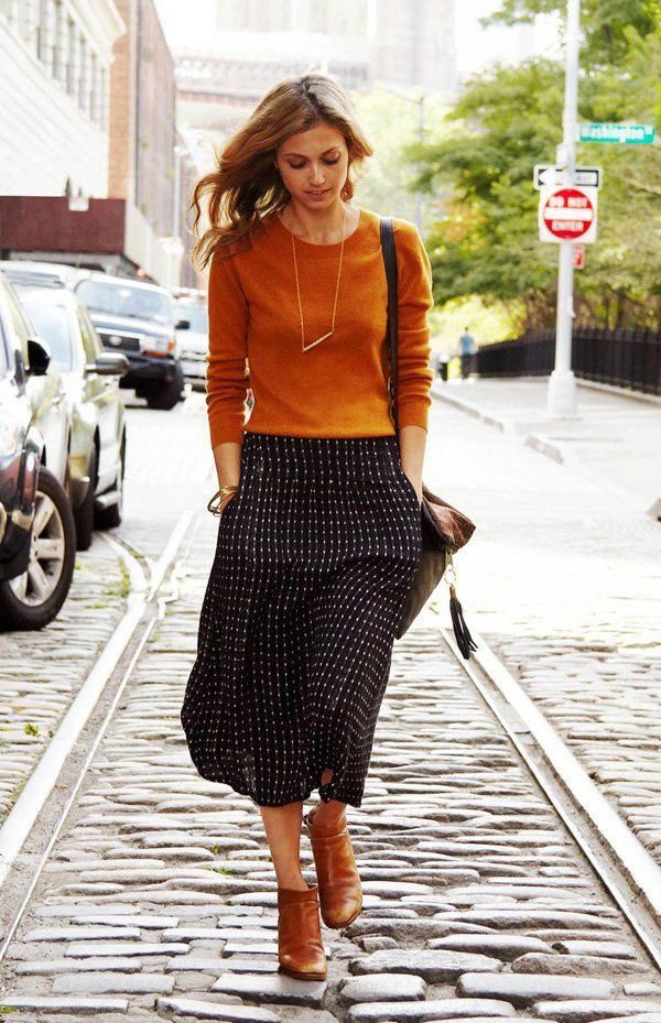 Burnt orange and black go well together for fall colors. Spice up your outfit with a necklace accessory killing the plain look of the top and giving it more life.