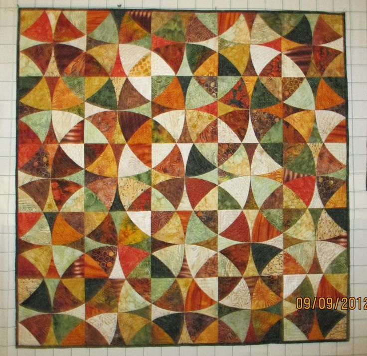 Winding Ways - almost looks like fallen leaves. What a great use for batiks!