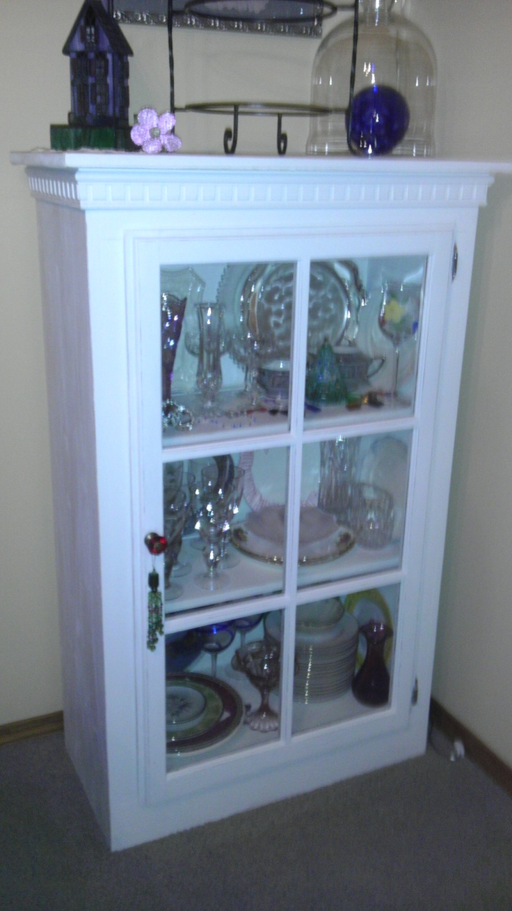 Cabinet made using old wood window, bead board, and moulding. Great in dining room for misc. items.