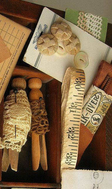 wrap ribbon and lace around old clothespins. Looks great in clear glass containers or a wooden bowl.