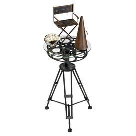 """End table with a tripod film reel silhouette.  Product: End tableConstruction Material: Metal and glassColor: BlackDimensions: 26"""" H x 14"""" Diameter"""