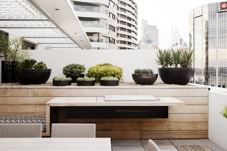 Cantilevered BBQ stand, stream line BBQ, custom Cameron Williams pots with succulents