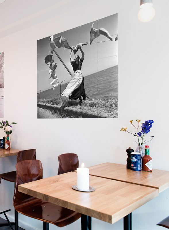 IXXI wall decoration made with an image of MAI Amsterdam with a woman doing laundry. The IXXI in this example will cost $108.25 (100 x 100 cm).#ixxi #ixxidesign