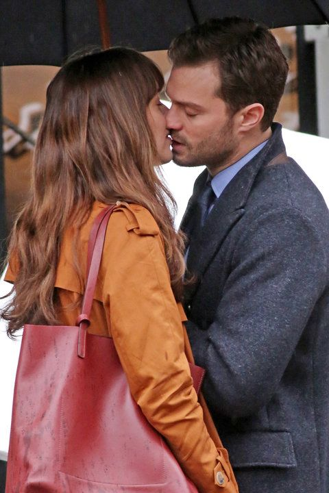 Dakota Johnson and Jamie Dornan Spotted Kissing While Filming Fifty Shades Darker from InStyle.com