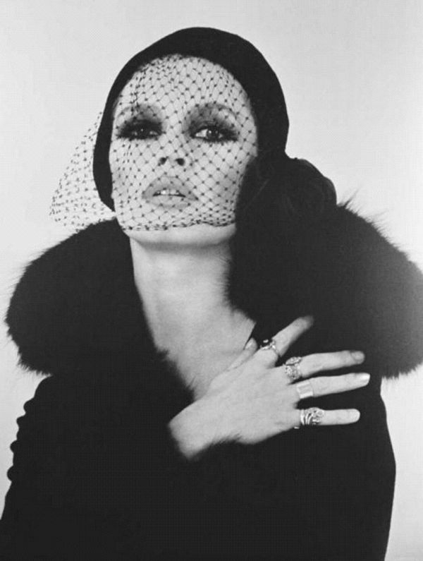 Brigitte Bardot with black veil, hat, and fur coat ...