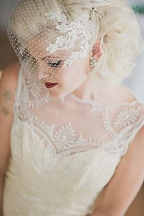 Vintage bride with birdcage veil and illusion neckline wedding dress. Click to see more veil trends here: http://www.mywedding.com/articles/9-veils-for-every-type-of-bride/