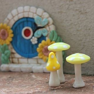 Blue Resin Door with Sunflowers and  yellow mushrooms.  Perfect for a spring garden.