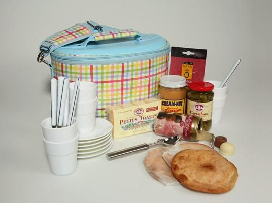 Moms-to-Be Cravings Cooler-- lighthearted survival kit from igourmet ($100) for a holiday midnight snack. The high points: a brightly patterned ice cream carrier, complete with saucers, bowls, and spoons for six, a clear, leak-proof carton holder, and a scoop. Also inside the cooler are tart, pickled French cornichons, creamy, natural peanut butter, crispy mini toasts, briny olives, sweet olive oil biscuits, and  Belgian chocolates packaged in a can.