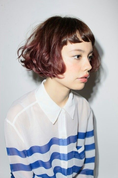 Wavy curly short bob with baby bangs