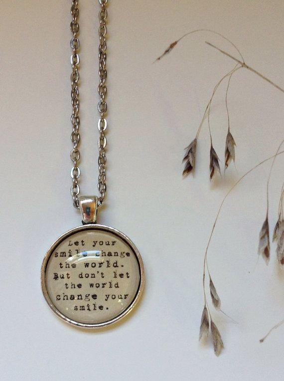 This pendant comes handmade with the quote let your smile change the world, but dot let the world change your smile. Perfect for a runner, a