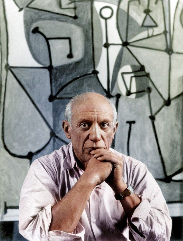 Pablo Picasso sits in front of his painting The Kitchen | Historical Photos Colorized and Brought Back to Life