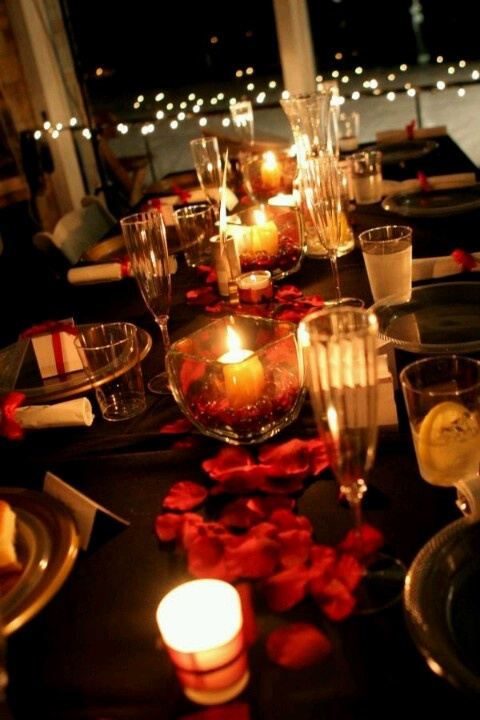 Love that black table cloth with the dark rose petals and candle light. Would be awesome with dark brown/gold plates.