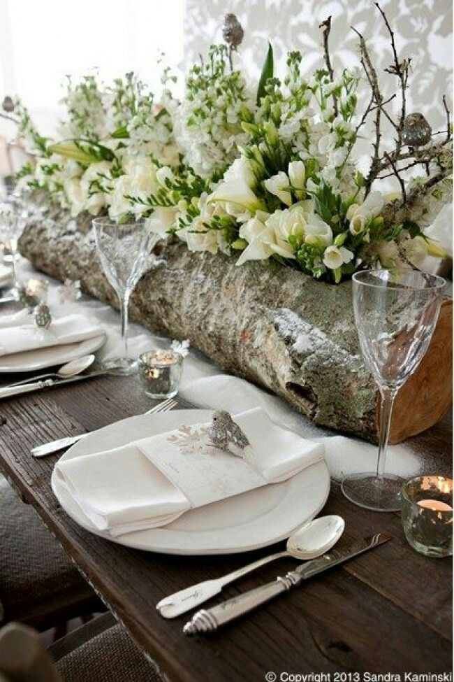 The log centerpiece and greenery