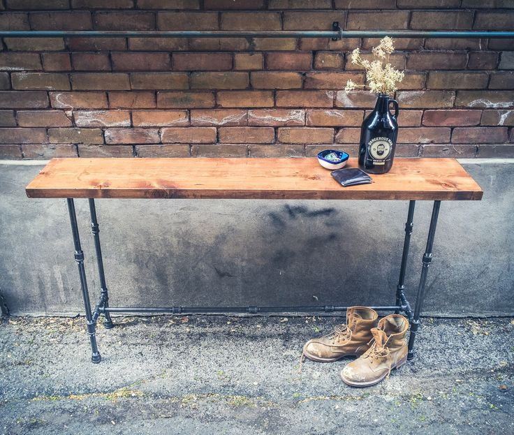 Wood and pipe console table || rustic console table || entryway table || foyer table || industrial chic || rustic sofa table || tv stand by PipeAndWoodDesigns on Etsy https://www.etsy.com/listing/232838880/wood-and-pipe-console-table-rustic