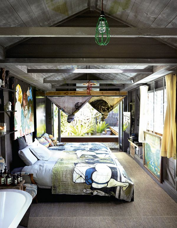 Bromley Yuge Home Bedroom with dark exposed wood walls and beams - Bohemian, eclectic, artistic - Wall to wall natural rug fooring