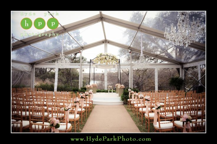 Gorgeous winter tented outdoor wedding ceremony at the Four Seasons Hotel in Downtown Austin, TX. Crystal chandeliers hung from the clear top tent. Photo by Austin wedding photographers, Hyde Park Photography. www.HydeParkPhotography.com