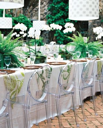 Lush green plants and white orchids line the table for a tropical wedding reception. #plant #wedding