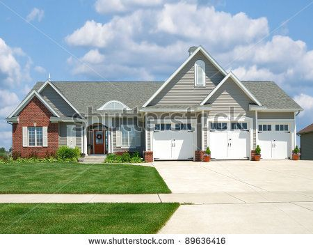 Stock Photo Modern Brick And Vinyl Siding House In The Suburbs With A Three Car