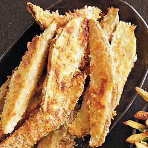 Parmesan-Coated Potato Wedges | Crunchy on the outside and creamy within, these wedges are like amped-up oven fries with the added appeal of Parmesan cheese.