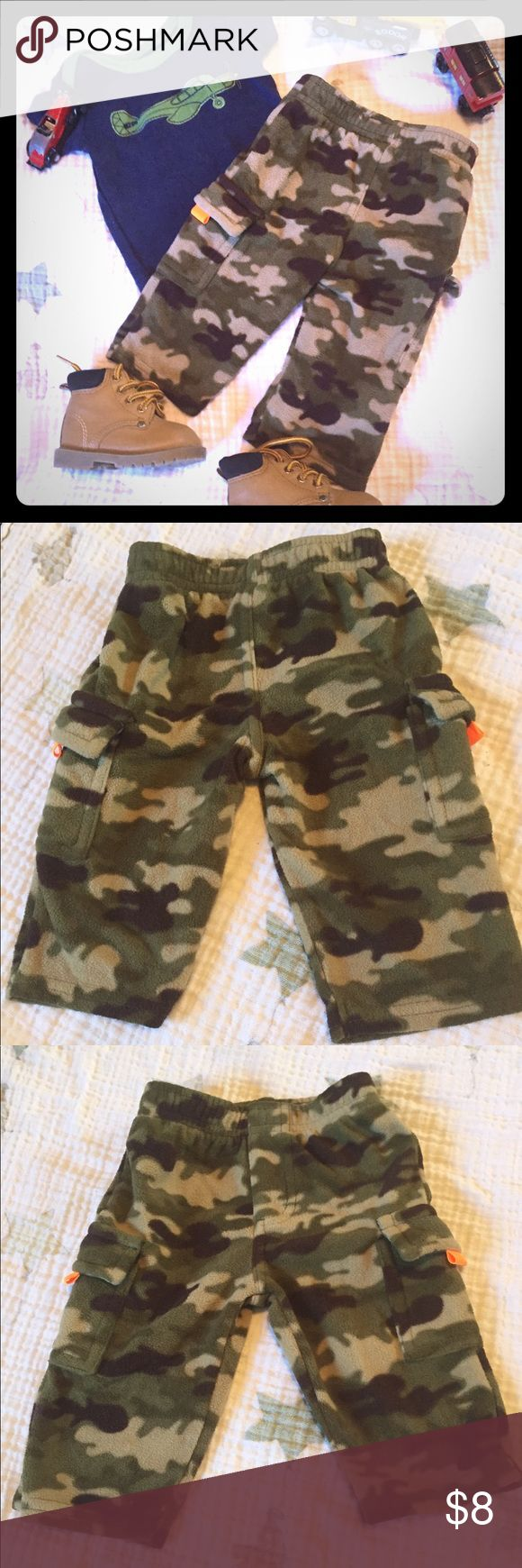 Garanimals 0-3 month fleece camouflage pants 👖 Keep your little adventure warm and cozy in these fleece pants! They are camouflage and have a pocket on each leg with an orange tab. They are green camouflage and would be easy to pair with most colors and a pair of boots to get your little stomping around.  Bundle for a special offer! Garanimals Bottoms Sweatpants & Joggers