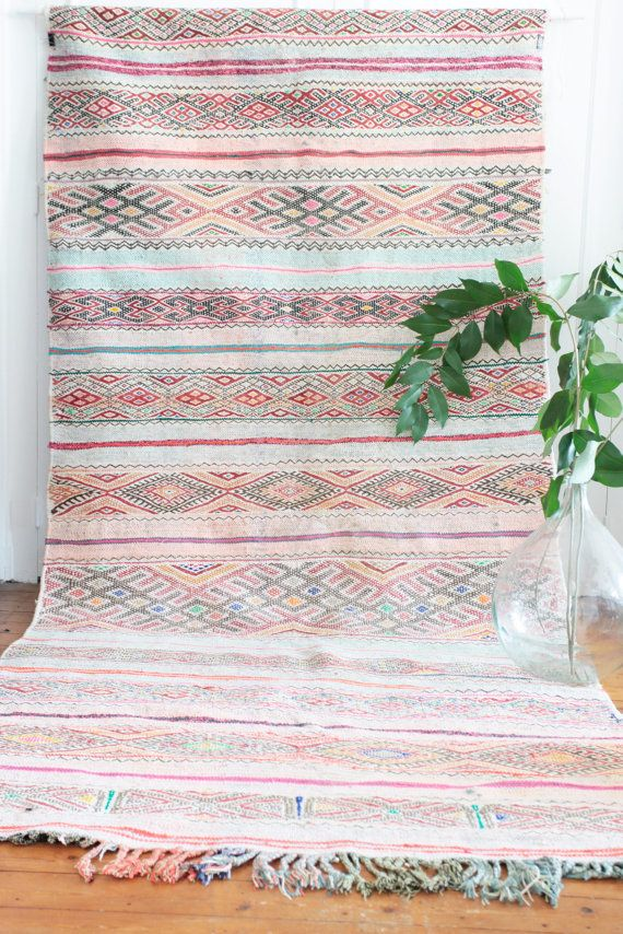 Moroccan kilim flatweave Boucherouite runner rug in pink. The rug is handwoven with recycled cotton scraps to create intricate and delicate