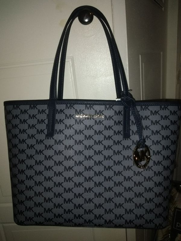 7ce648c82970 Authentic Michael Kors tote bag for Sale in Galloway